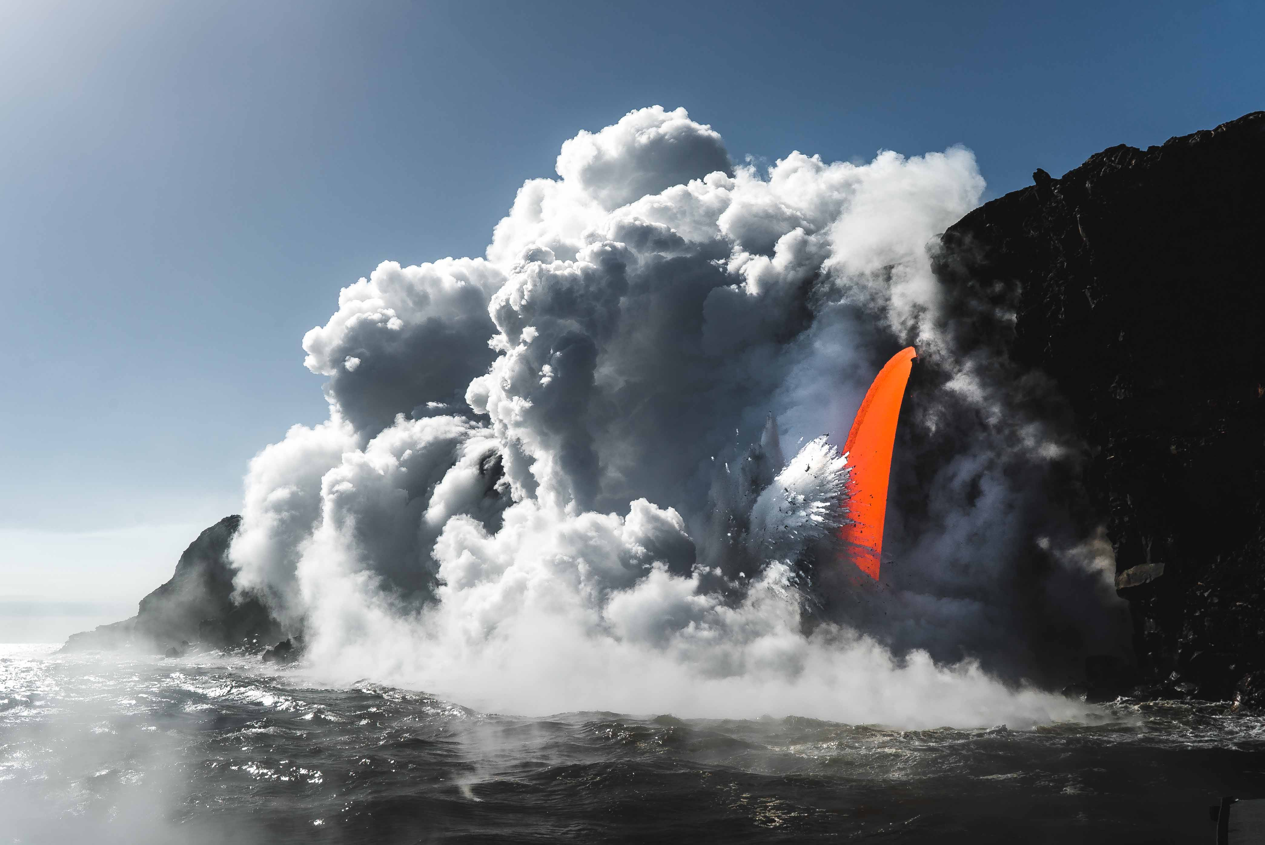 Photography of a lava spout (fire-hose) at Hawaii Volcanoes National Park