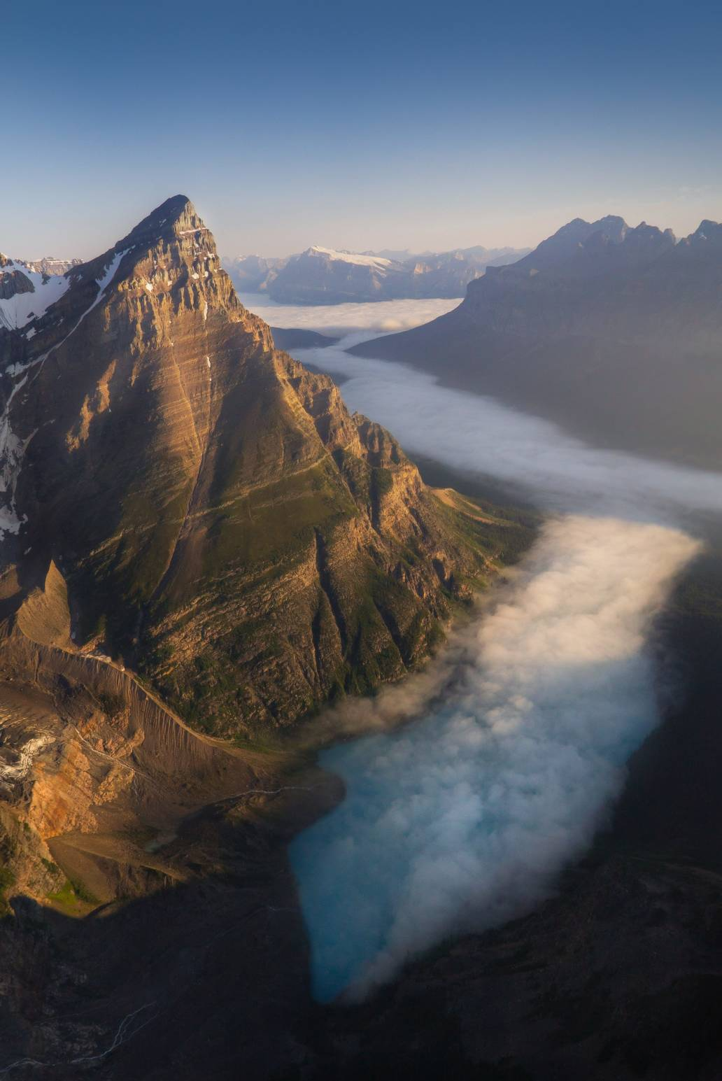 Aerial photography of a mountain during sunrise in Banff National Park, Canada. Taken from a helicopter