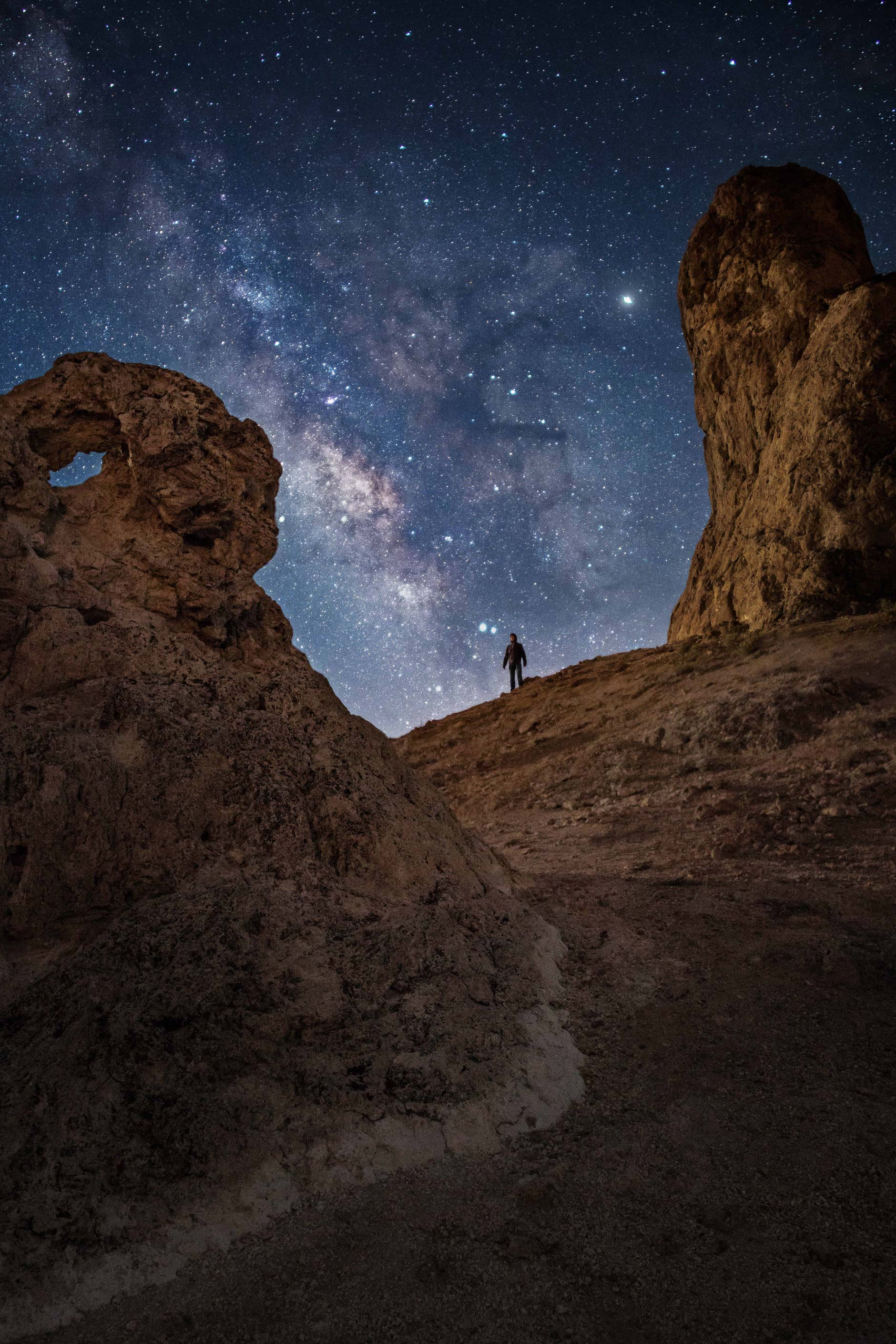 Star photography of the desert and a person