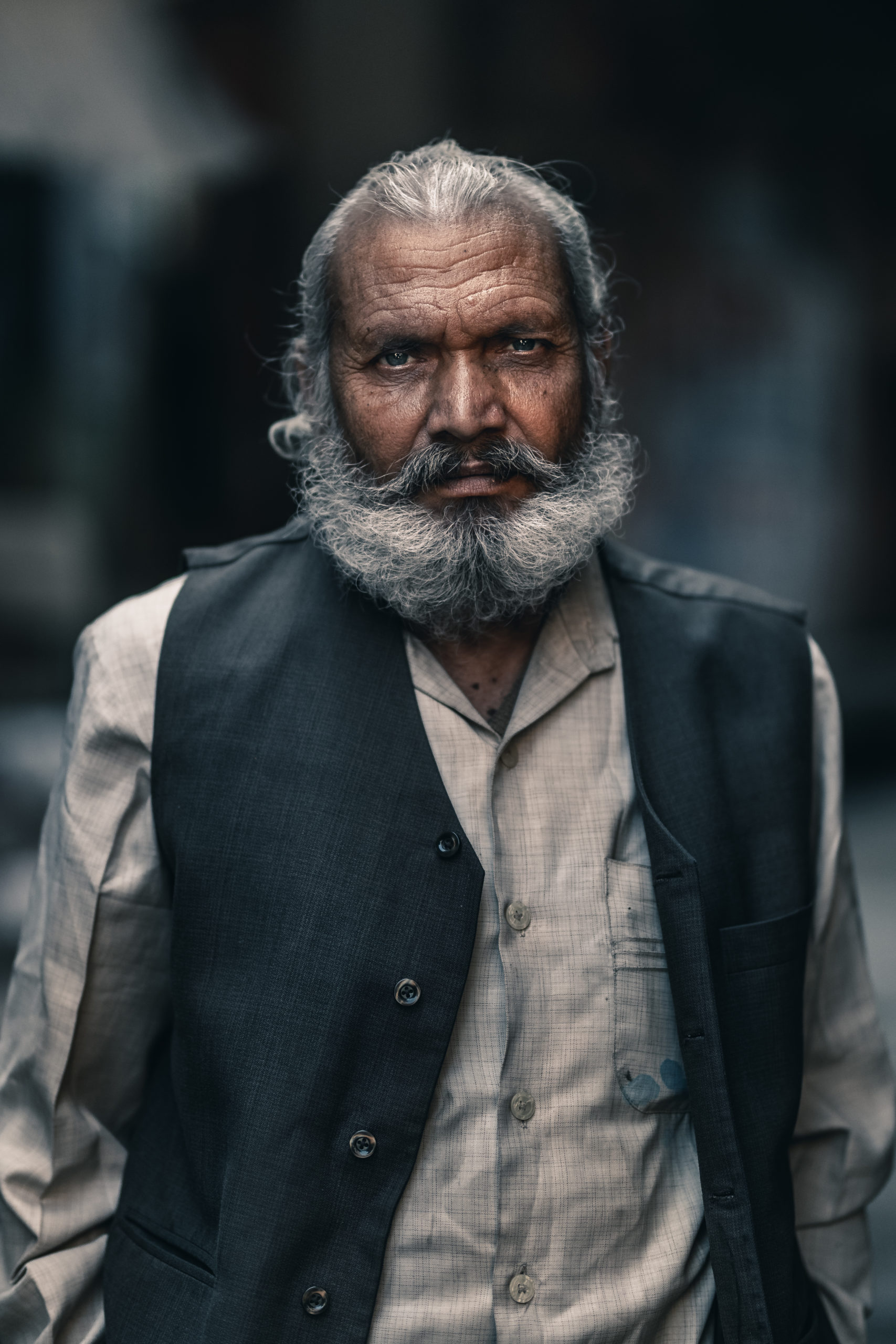 Portrait street photography of an old man in the streets of Mathura, India