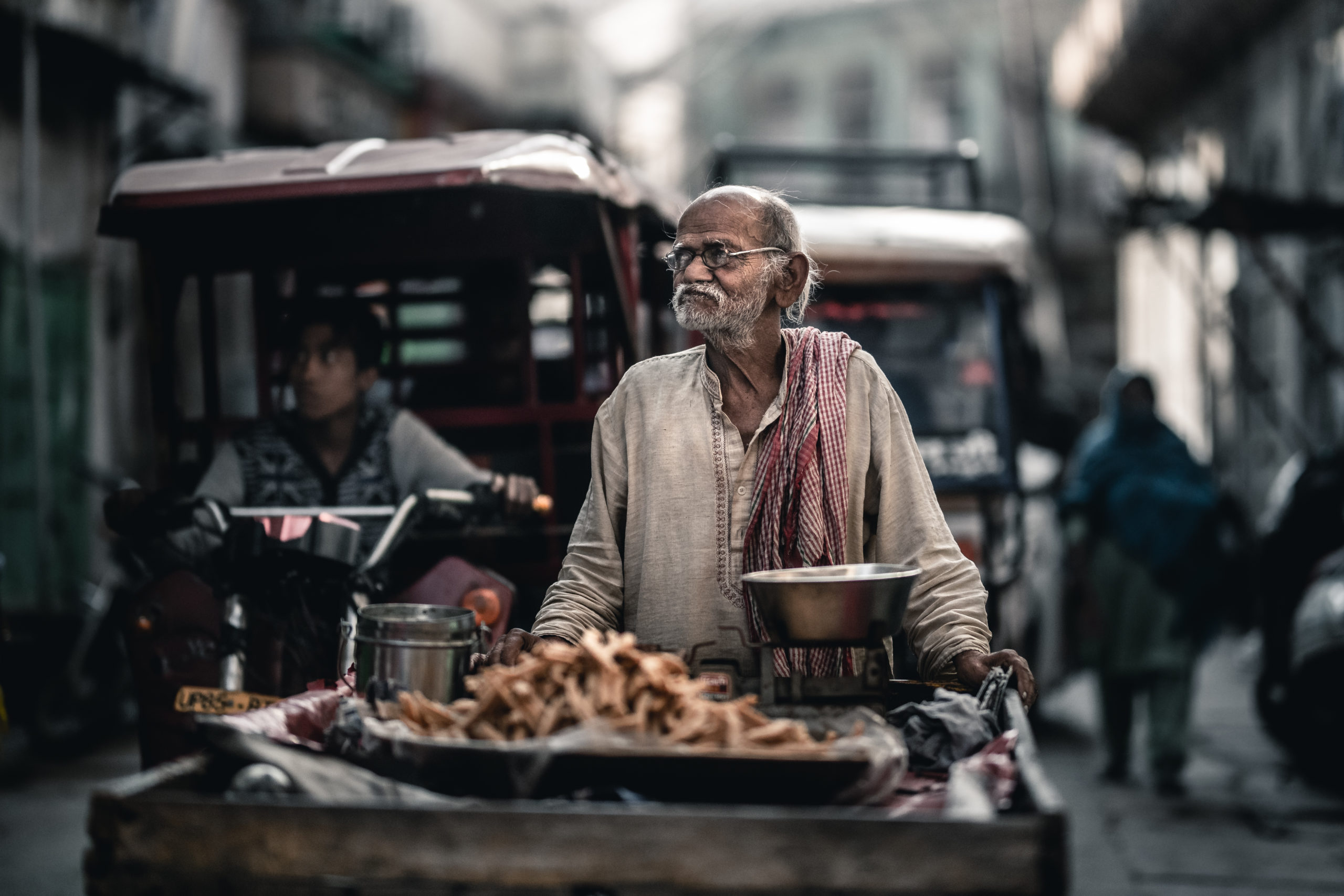 Portrait-street photography of a rickshaw driver walking in the streets of Mathura, India