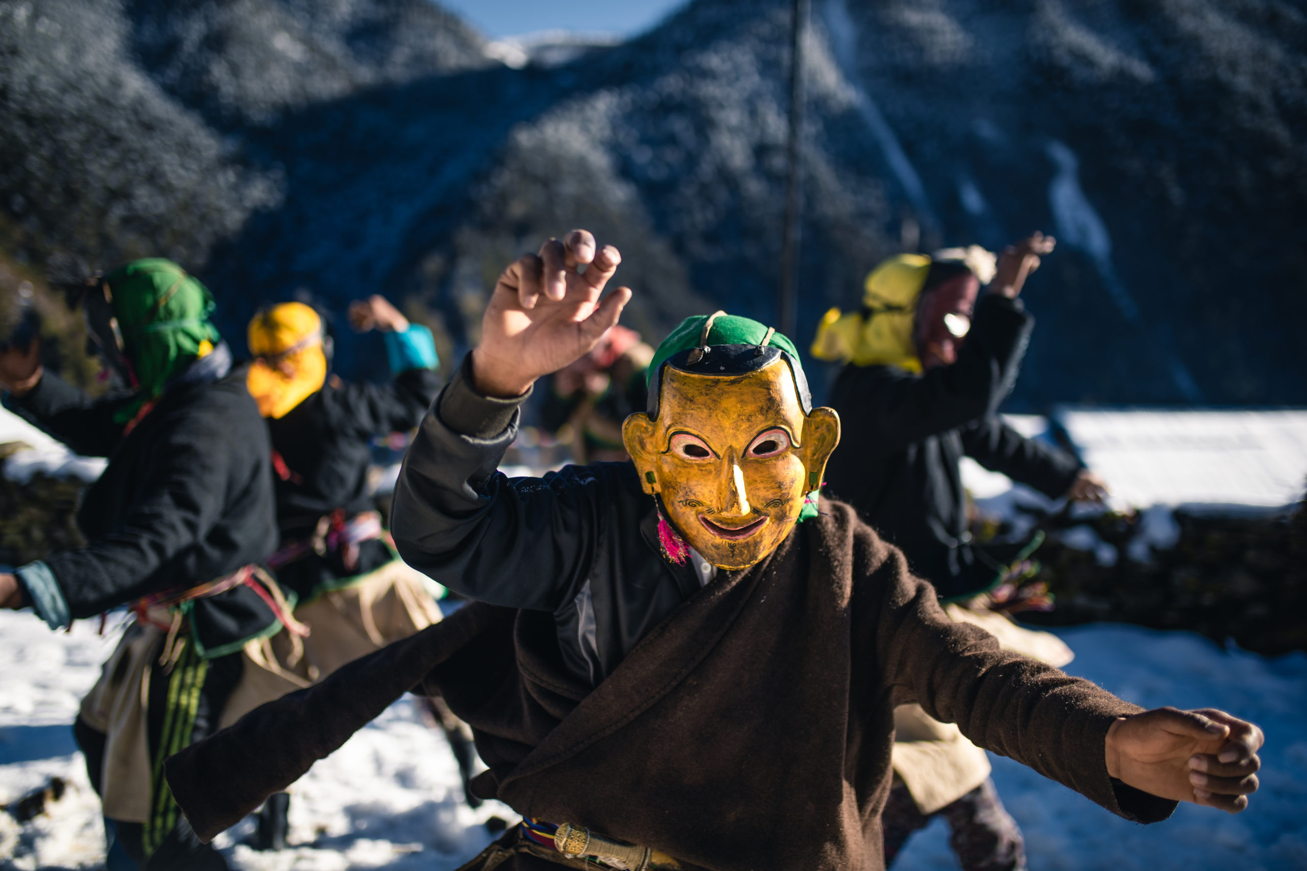 Photography of Bhutan's Traditional Masked Dancers dancing in Merak.