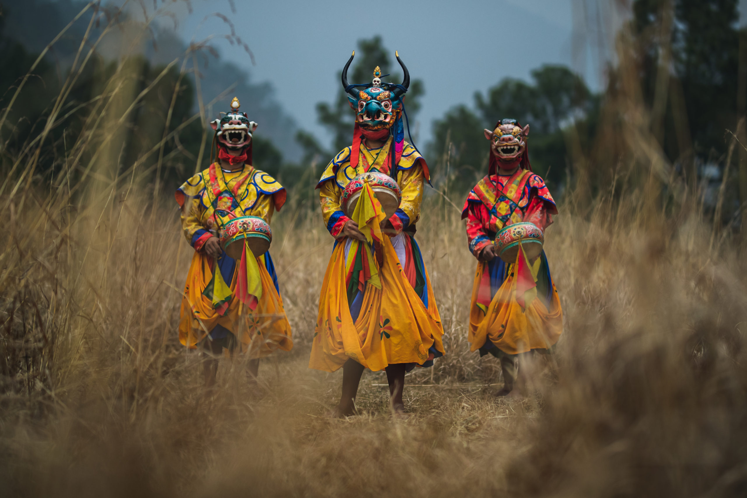 Photography of Bhutan's traditional masked dancers in Punakha