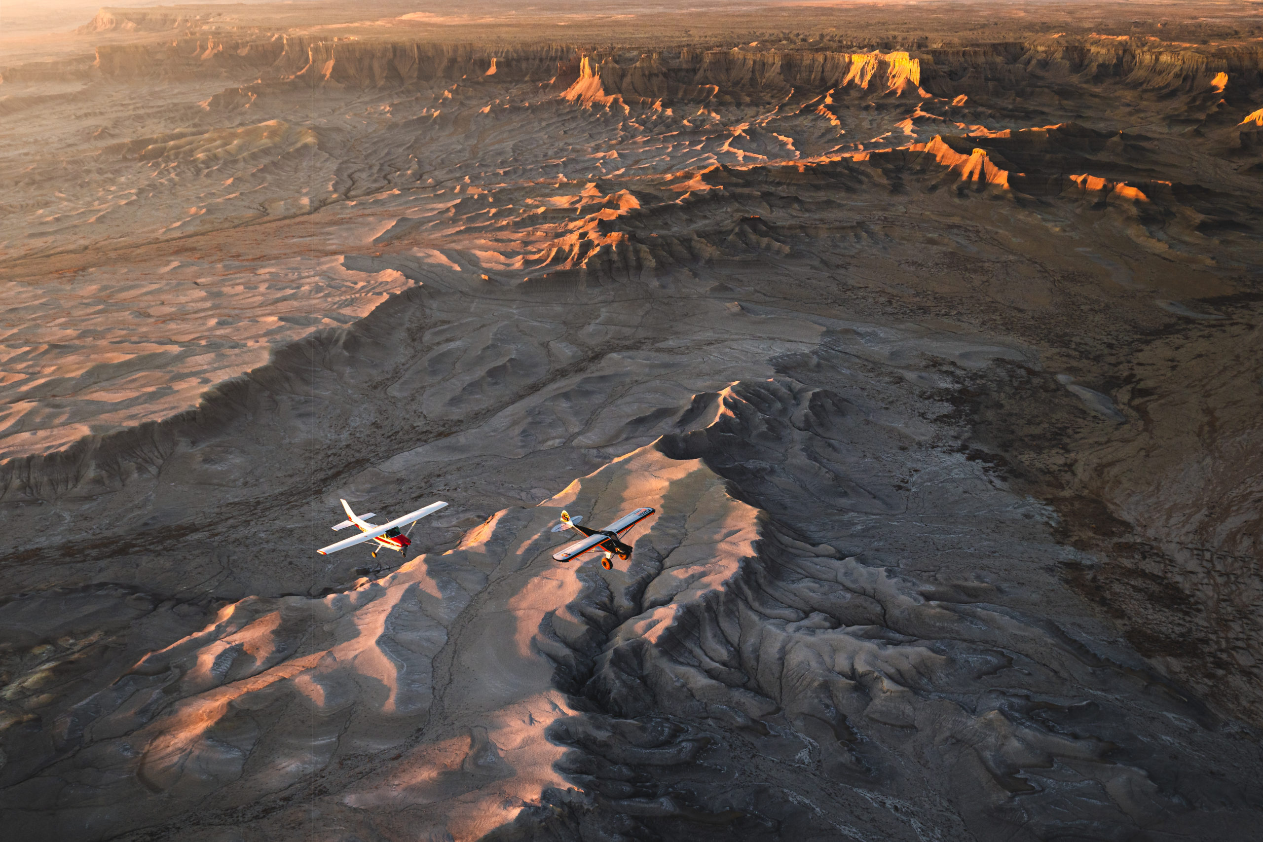 Aviation Landscape Photography of two planes flying over Southern Utah